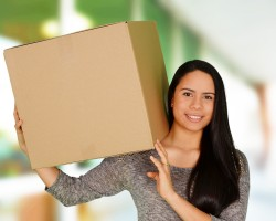A woman presenting the Moving boxes by Irish Moving New York